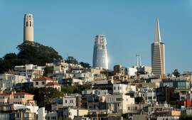 Flanked by Coit Tower and the Transamerica Pyramid, the Salesforce tower rises above San Francisco on Saturday, Aug. 26, 2017.