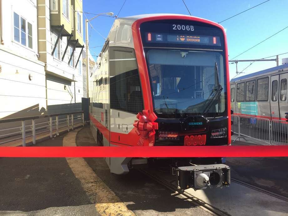 SFMTA debuted the first new Muni train, one of more than 200 cars to be released in coming months, at the Church St. and Duboce Ave. station on Friday, Nov. 17, 2017. The new cars will be quieter, lighter and fit more people, SFMTA said. Photo: Michelle Robertson/SFGATE