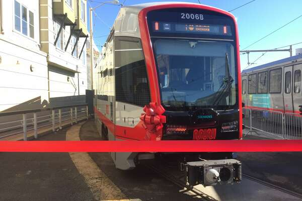 SFMTA debuted the first new Muni train, one of more than 200 cars to be released in coming months, at the Church St. and Duboce Ave. station on Friday, Nov. 17, 2017. The new cars will be quieter, lighter and fit more people, SFMTA said.