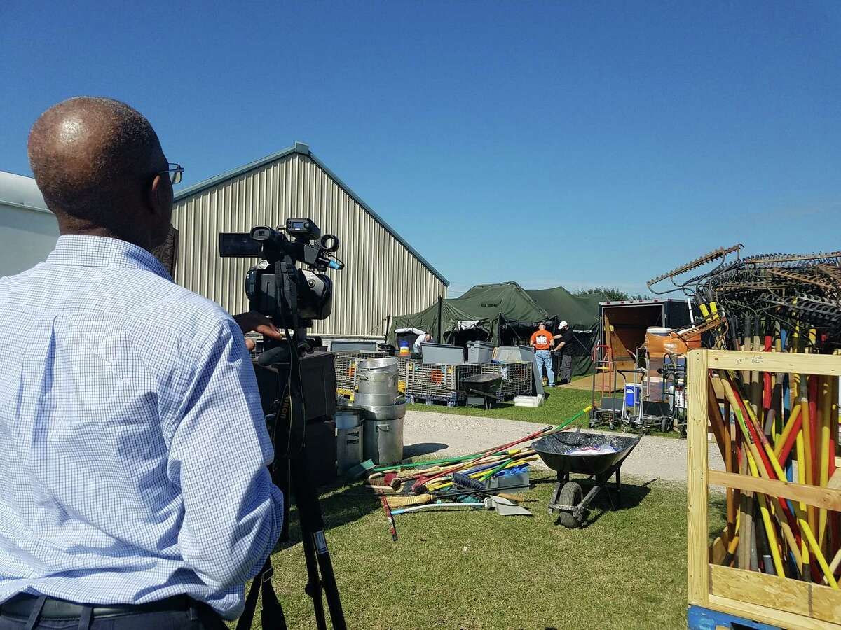 """Above left: Elgin Alexander works on location in Cypress filming """"What Mercy Looks Like."""""""
