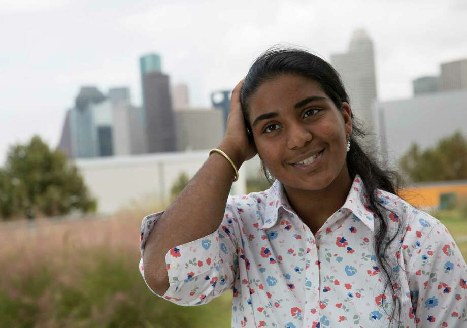 Houston's new Youth Poet Laureate Rukmini Kalamangalam, a 16-year-old senior at Carnegie Vanguard High School, performs her poem for a portrait at the school in Houston. Photo: Yi-Chin Lee, Houston Chronicle / © 2017 Houston Chronicle