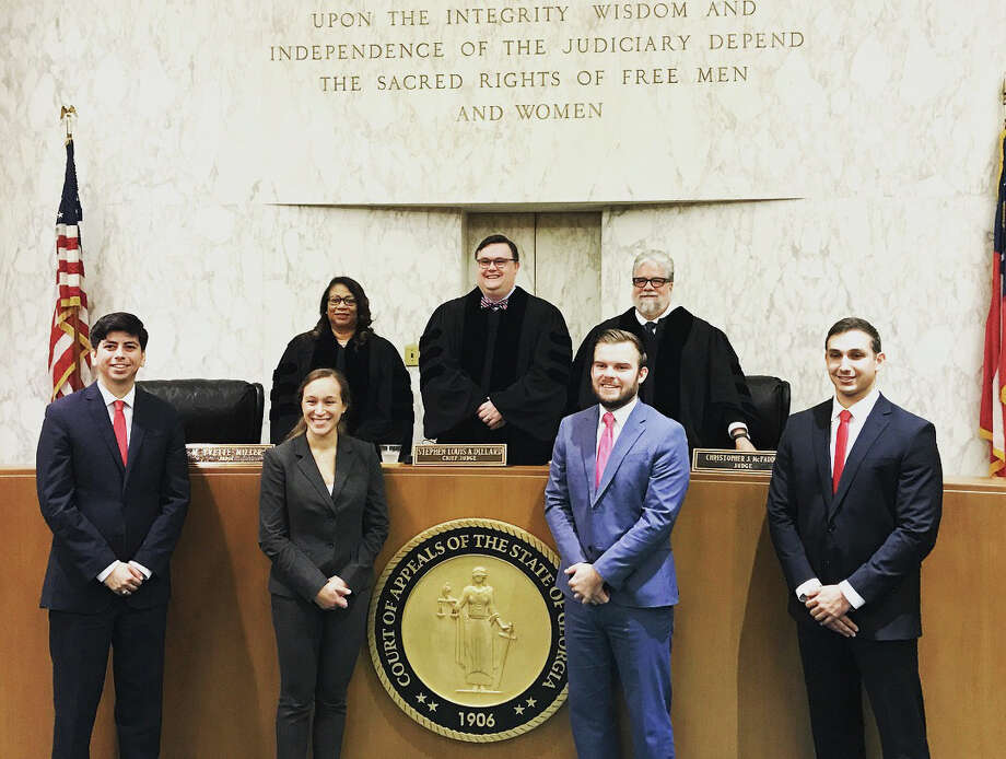 STCLH was victorious at the National Latina/o Law School Student Association Moot Court Competition in Atlanta. Shown are (second row) Judge Yvette Miller, Chief Judge Stephen Louis A. Dillard and Judge Christopher J. McFadden; and (front row) Cesar Escalante, two University of North Carolina law school finalist team members, and Jonathan Pena.
