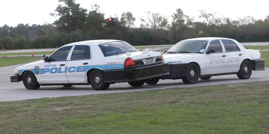 Houston Police officers demonstrate a pursuit intervention technique called the PIT Maneuver, a pursuit tactic by which a pursuing car forces a fleeing car to abruptly turn sideways, shown at the Houston Police Training Academy, 17000 Aldine Westfield Rd., Thursday, Nov. 16, 2017, in Houston.  HPD will soon begin allowing trained officers to use the chase maneuver, saying it will allow them to end vehicle pursuits more quickly. Photo: Melissa Phillip, Houston Chronicle / © 2017 Houston Chronicle