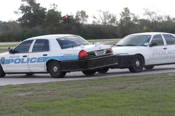 Houston Police officers demonstrate a pursuit intervention technique called the PIT Maneuver, a pursuit tactic by which a pursuing car forces a fleeing car to abruptly turn sideways, shown at the Houston Police Training Academy, 17000 Aldine Westfield Rd., Thursday, Nov. 16, 2017, in Houston.  HPD will soon begin allowing trained officers to use the chase maneuver, saying it will allow them to end vehicle pursuits more quickly.