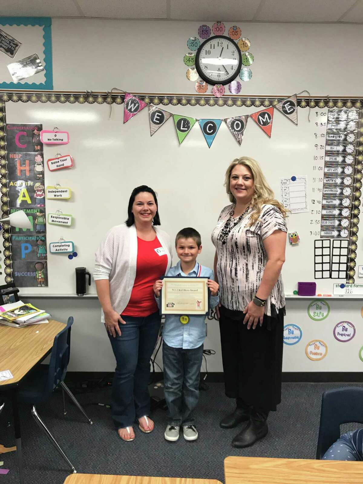 James Pugh, 7, of Conroe, called 911 and saved his mom's life after she fell unconscious in September. On Monday, Nov. 13, the Montgomery Country Emergency Communication District presented him with the 911 Kid Hero Award. (submitted photo)