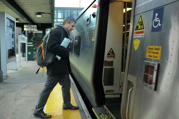 Dom Alessandro, of Danbury, a graphic designer who commutes regularly to Manhattan, boards the 7:33 a.m. train at Purdys train station Friday morning.