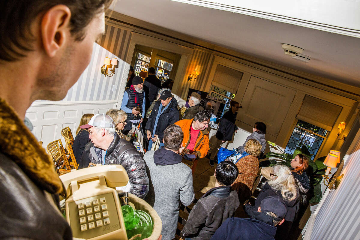 Shoppers browse items during the estate sale at the Grey Gardens house in East Hampton, New York, on Nov. 17, 2017. (