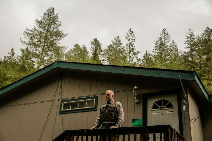 Ranger Jonathan Umholtz stands for a portrait on the porch of his home which is in Hood Mountain Regional Park in Santa Rosa, Calif., on Thursday, Nov. 16, 2017. Jonathan will have to move from his home because his house will likely be wiped out by a mudslide.