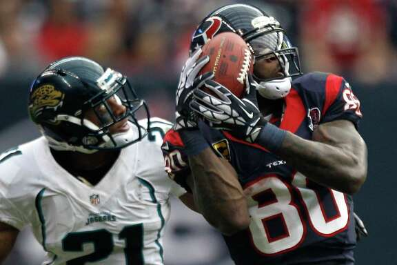 Houston Texans wide receiver Andre Johnson (80) beats Jacksonville Jaguars cornerback Derek Cox (21) for a reception during the fourth quarter at Reliant Stadium on Sunday, Nov. 18, 2012, in Houston. The Texans beat the Jaguars 43-37. ( Brett Coomer / Houston Chronicle )