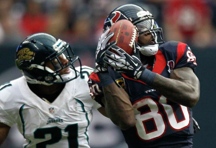 In what some regard as his greatest game Nov. 18, 2012, Andre Johnson, right, had 14 catches for 273 yards and the game-winning touchdown in a 43-37 victory over the Jaguars in overtime. Photo: Brett Coomer, Staff / © 2012  Houston Chronicle