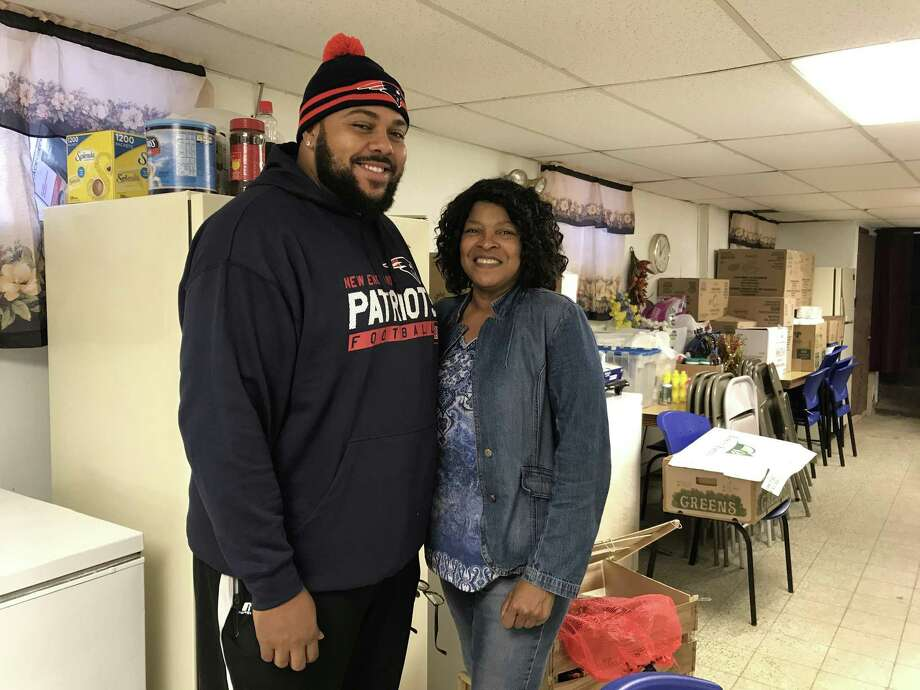 Brandon Baro and Tanya Butler inside the basement of Church of God and Saints of Christ on Friday, Nov. 17, in New Haven. Baro and Butler are helping coordinate the church's annual free Thanksgiving Day dinner. Photo: Esteban L. Hernandez / Hearst Connecticut Media