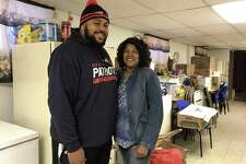 Brandon Baro and Tanya Butler inside the basement of Church of God and Saints of Christ on Friday, Nov. 17, in New Haven. Baro and Butler are helping coordinate the church's annual free Thanksgiving Day dinner.