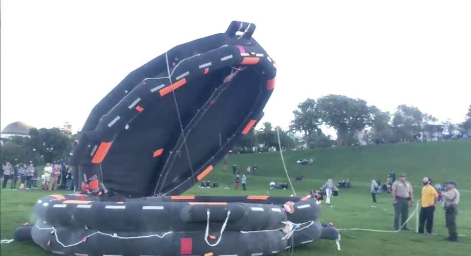 Inflatable life rafts deployed at Dolores Park on Nov. 11, 2017. Photo: Victoria Dobbs / YouTube Screen Capture