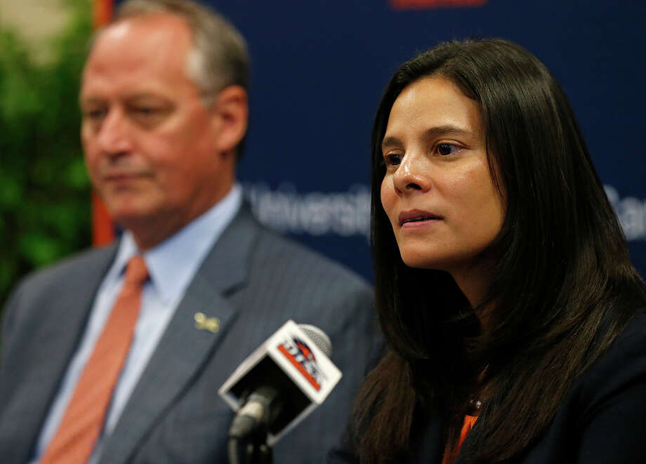 UTSA's new athletics director Lisa Campos speaks during a press conference held Friday Nov. 17, 2017 at the campus. UTSA president Taylor Eighmy is pictured in background. Photo: Edward A. Ornelas, San Antonio Express-News / © 2017 San Antonio Express-News
