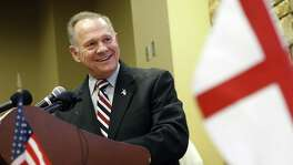 Former Alabama Chief Justice and U.S. Senate candidate Roy Moore speaks at the Vestavia Hills Public library in Vestavia Hills, Ala. A reader says Moore is being beiseged by false allegations of sexual misconduct.
