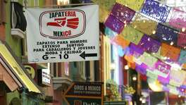 Signs point to hispanic businesses at a mall in Chamblee, Ga. in 2006. America, with Trump leading the way, has taken to blaming Latinos for ills they don't create.