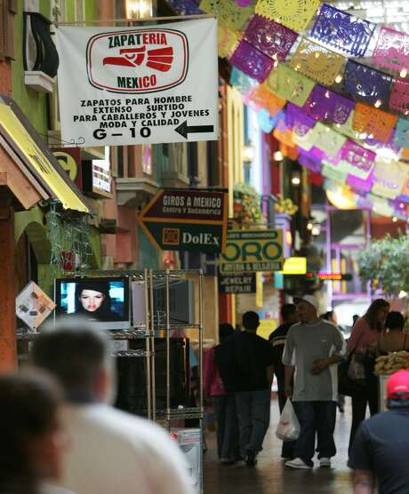 Signs point to hispanic businesses at a mall in Chamblee, Ga. in 2006. America, with Trump leading the way, has taken to blaming Latinos for ills they don't create. Photo: JOHN AMIS /AP / AP