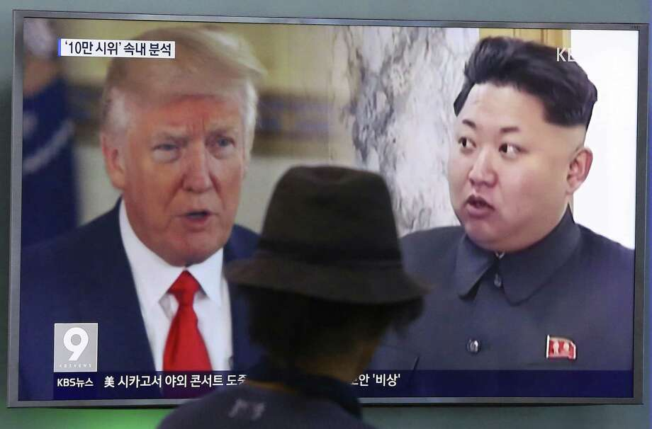 A split TV screen in Seoul shows U.S, President Donald Trump and North Korean leader Kim Jong Un during a news program. A reader is amused by the insults the two leaders are hurling at each other. Photo: Ahn Young-joon /Associated Press / Copyright 2017 The Associated Press. All rights reserved.