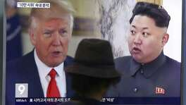 A split TV screen in Seoul shows U.S, President Donald Trump and North Korean leader Kim Jong Un during a news program. A reader is amused by the insults the two leaders are hurling at each other.