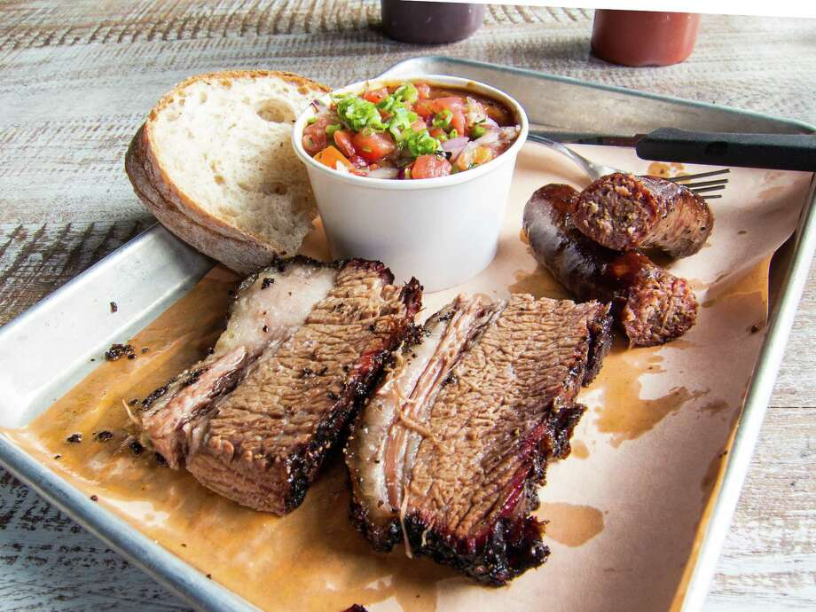 Salt & Bone Smokehouse in Astoria, Queens, serves brisket, sausage and beans. Photo: J.C. Reid