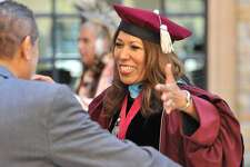 Cynthia Teniente-Matson greets well-wishers in 2015 following her inauguration as the president of Texas A&M University-San Antonio. The school is embarking on programs that address the needs of its student body, many of whom are low-income Latinos and the first in their families to attend college.