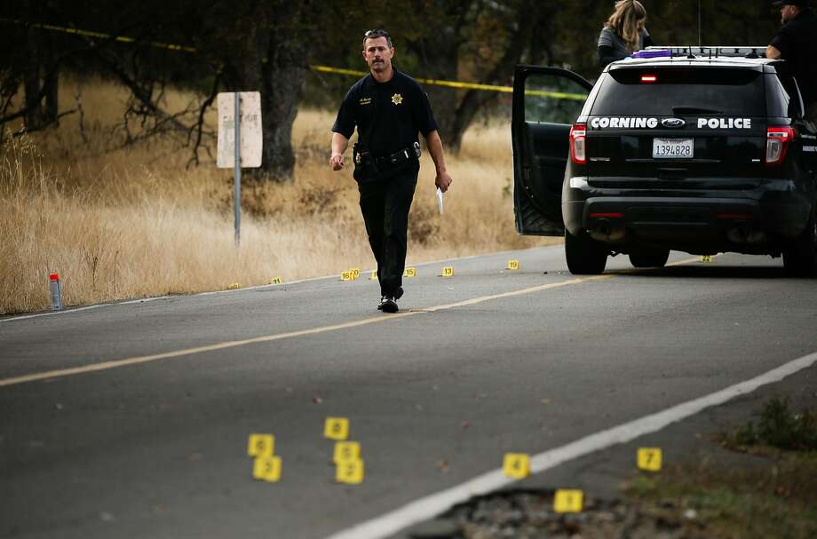 A police officer walks near one of the crime scenes after a shooting rampage in Rancho Tehama Reserve (Tehama County) that killed five people last week. Photo: ELIJAH NOUVELAGE, AFP/Getty Images