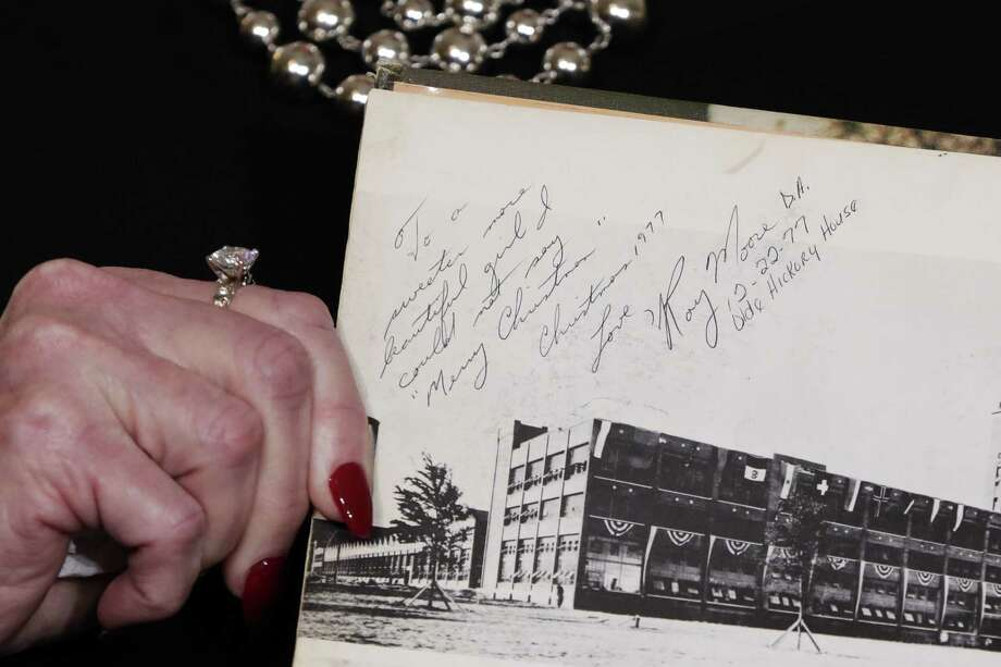 Beverly Young Nelson, the latest accuser of Republican U.S. Senate candidate Roy Moore, displays her high school yearbook signed by Moore on Monday. Nelson says Moore assaulted her when she was 16. Moore's recent interview with Sean Hannity did little to dispel concerns about the candidate. Photo: Richard Drew / Associated Press / AP