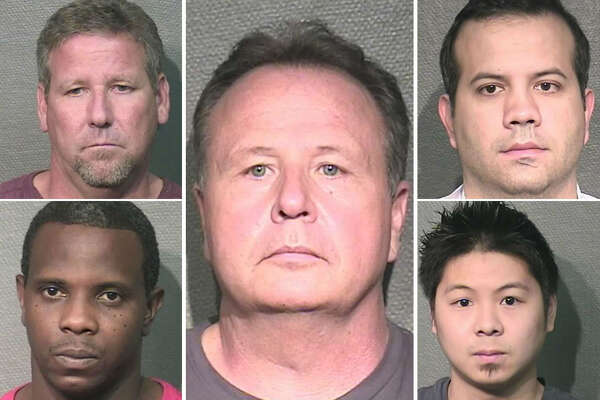 Houston police officer Robert Teweleit, 54, center, was arrested Oct. 4 during a 10-day HPD sting at a massage parlor turned brothel. He was among 139 people arrested.