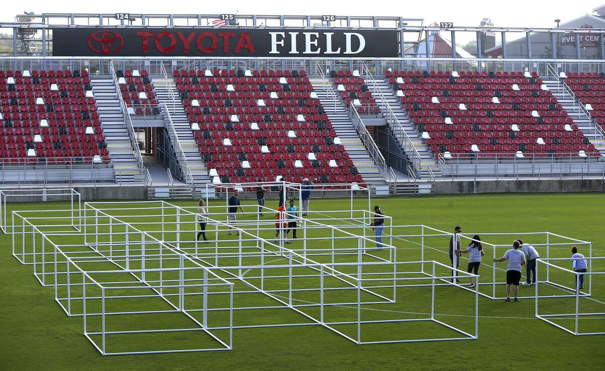 Volunteers put a framework of PVC pipe together Friday November 17, 2017 at Toyota Field in an effort to build the world's largest blanket fort. The fort is being built for the Autism Uncovered community event created to bring awareness to the importance of early intervention and the need for autism services in San Antonio. After the event, the blankets will be donated to Haven for Hope and the PVC pipe will be donated to Habitat for Humanity. Proceeds for the event on Saturday November 18, 2017 will benefit the Autism Treatment Center.