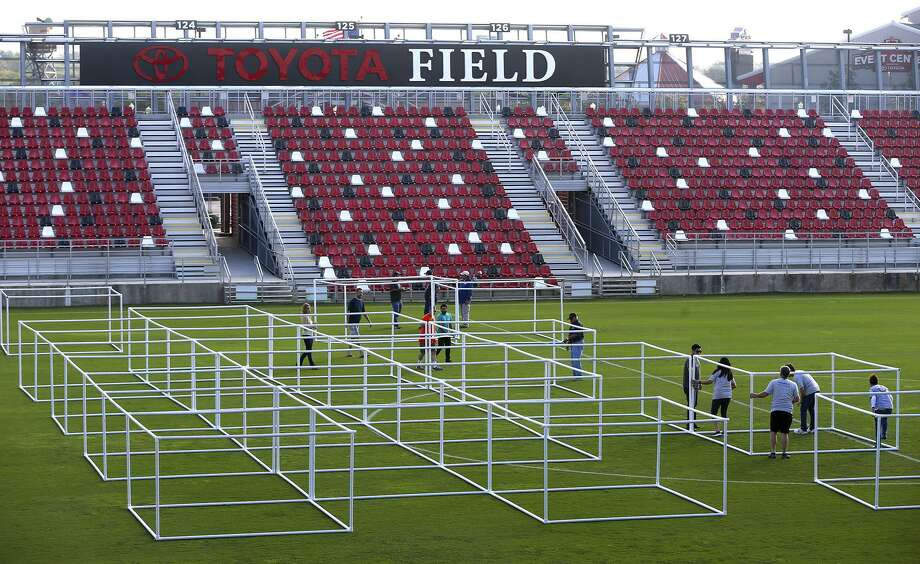 Volunteers put a framework of PVC pipe together Friday November 17, 2017 at Toyota Field in an effort to build the world's largest blanket fort. The fort is being built for the Autism Uncovered community event created to bring awareness to the importance of early intervention and the need for autism services in San Antonio. After the event, the blankets will be donated to Haven for Hope and the PVC pipe will be donated to Habitat for Humanity. Proceeds for the event on Saturday November 18, 2017 will benefit the Autism Treatment Center. Photo: John Davenport, STAFF / San Antonio Express-News / ©John Davenport/San Antonio Express-News