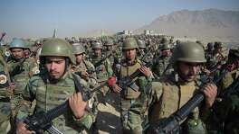 Afghan National Army soldiers march during a military exercise at the Kabul Military Training Center in Afghanistan last month. More than 150 Afghan military personnel sent to the U.S. for training since 2005 have gone AWOL, including 60 from Joint Base San Antonio.