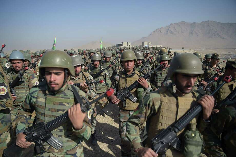 Afghan National Army soldiers march during a military exercise at the Kabul Military Training Center in Afghanistan last month. More than 150 Afghan military personnel sent to the U.S. for training since 2005 have gone AWOL, including 60 from Joint Base San Antonio. Photo: SHAH MARAI /AFP /Getty Images / AFP or licensors