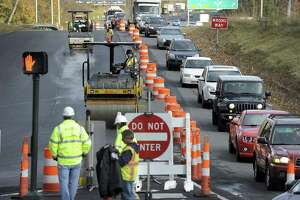 Contractors are making the final improvements to the long delayed construction project along Padanaram Road that is expected to relieve traffic in the area. Crews are paving the area, including the Exit 6 off ramp in Danbury, Thursday, Nov. 16, 2017.