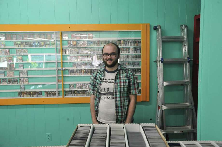 Torrington native Eric Charron recently opened Super Games IRL, the second in a line of hobby game stores, on Wall Street in Torrington. Photo: Ben Lambert / Hearst Connecticut Media
