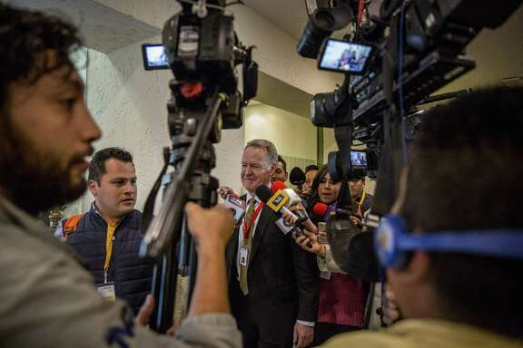 Steve Verheul, Canada's chief negotiator, center, walks with members of the media during the fifth round of North American Free Trade Agreement (NAFTA) renegotiations in Mexico City, Mexico, on Friday, Nov. 17, 2017. The lead negotiators for the three NAFTA countries joined the latest round of talks as the U.S. Chamber of Commerce warned that an American pullout would hit hardest some key swing states that President Donald Trump took on his road to power.