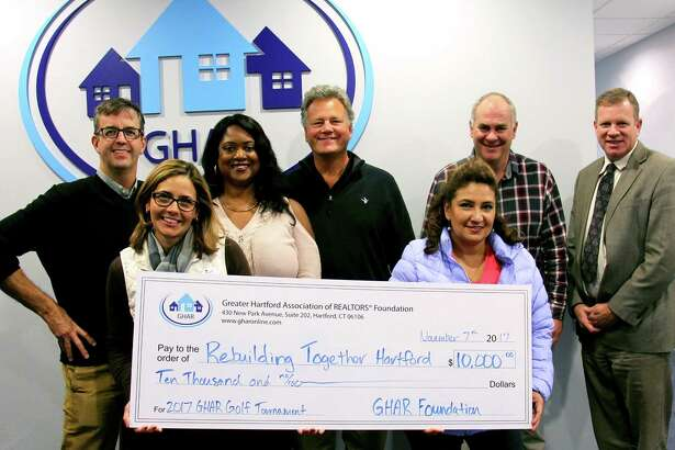 From left are Garth Meehan, GHAR Golf Committee member; Jodie Liddy, Executive Director of Rebuilding Together Hartford, and GHAR Golf Committee members: Leslie Mattos, Barry Faticoni, Adriana Burgos, Scott Henry and Committee Chair Mike Tracy.