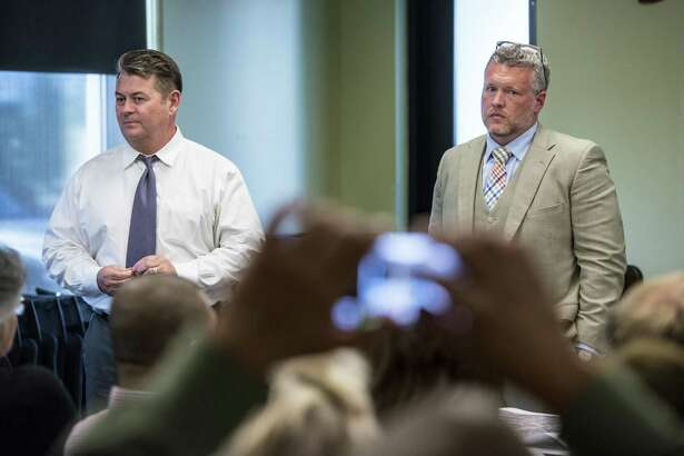 """Michael Wibracht, president of 210 Development Group, right, and Mark Tolley, a 210 Development partner, listen to local residents at a 2015 meeting concerning one of their projects. Wibracht has accused his ex-wife of engaging in """"threats"""" and """"physical and mortal violence."""""""