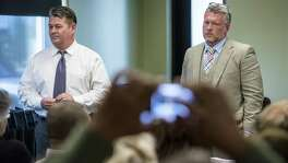 "Michael Wibracht, president of 210 Development Group, right, and Mark Tolley, a 210 Development partner, listen to local residents at a 2015 meeting concerning one of their projects. Wibracht has accused his ex-wife of engaging in ""threats"" and ""physical and mortal violence."""
