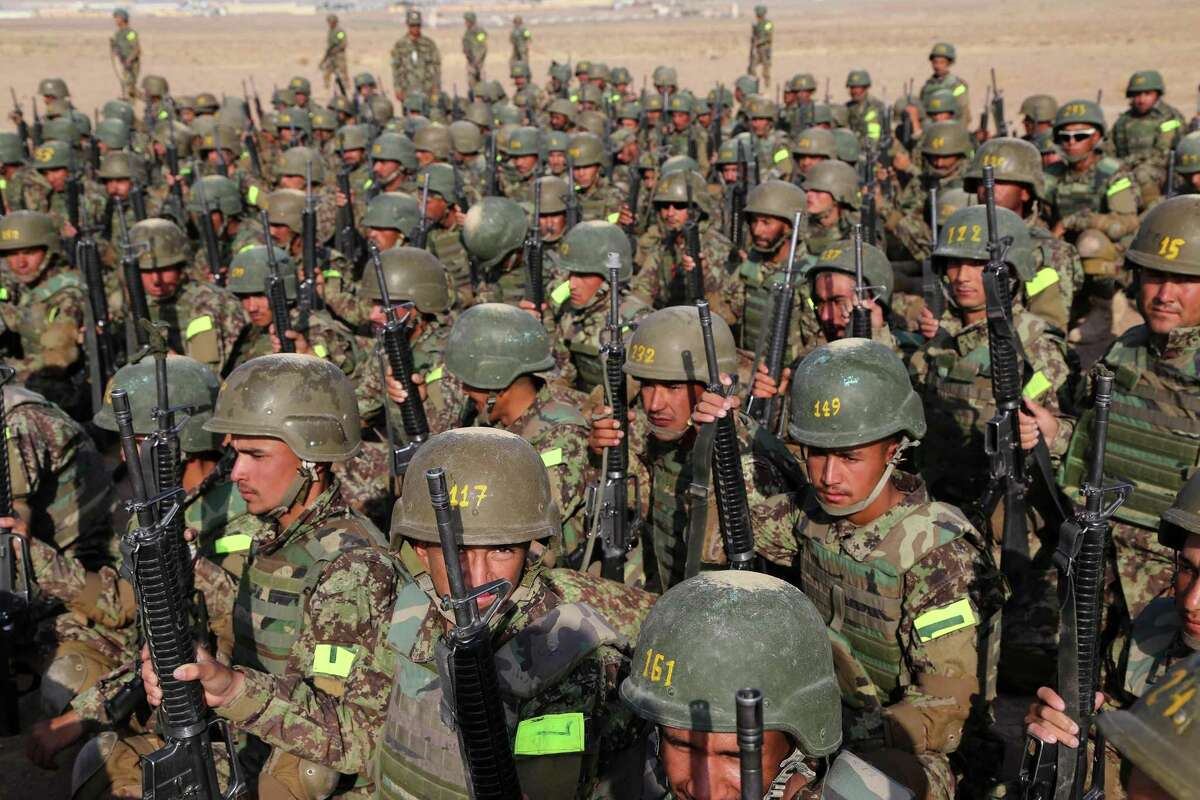 Afghan army soldiers take part in military exercises at a training center in western Afghanistan last year. More than 150 Afghan military personnel who have traveled to the U.S. for training since 2005 have gone AWOL, including 60 from Joint Base San Antonio.