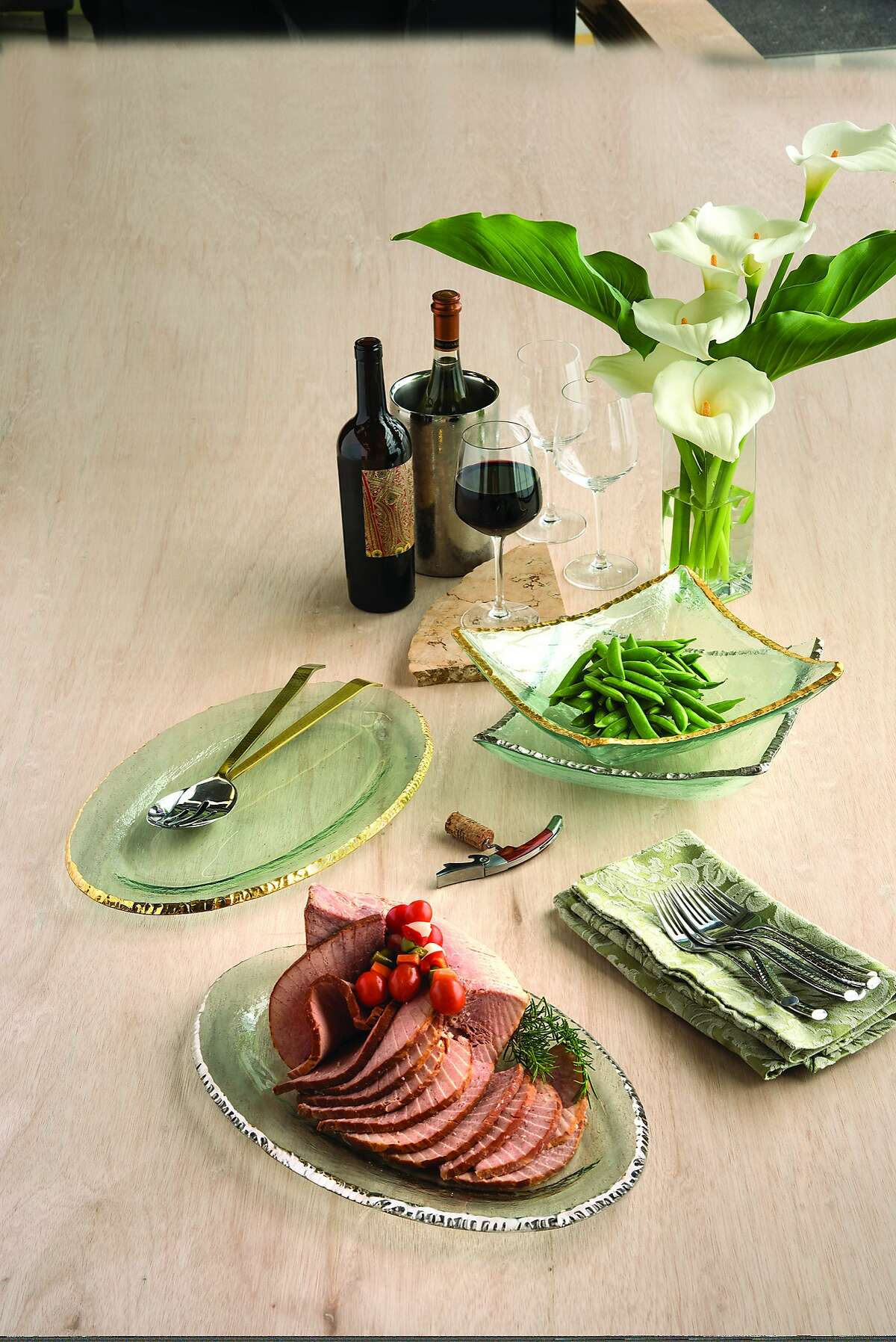 """The Edgey collection's platters and bowls ($179-$221) are good for a cheese spread, and """"could also be used with tealight & evergreens, maple leaves, or scattering of herbs,"""" says Annieglass founder Annie Morhauser."""