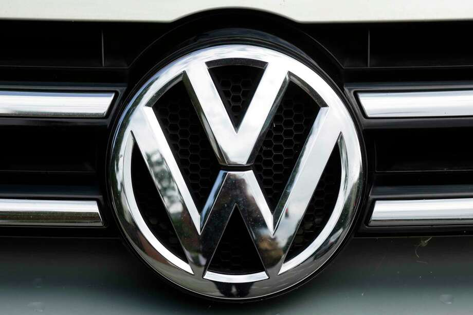 FILE - This Tuesday, Aug. 1, 2017, file photo shows the brand logo of German car maker Volkswagen on a car in Berlin. U.S. safety regulators are investigating complaints that a Volkswagen recall may not fix a wiring problem that can stop the front driver's air bag from inflating in a crash. The government probe covers nearly 416,000 vehicles including the 2010 to 2014 CC and Passat, the 2010 to 2013 Eos, the 2011 to 2014 Golf, GTI, Jetta and Tiguan, and the 2012 to 2014 Jetta Sportwagen. (AP Photo/Markus Schreiber, File) ORG XMIT: NYBZ533 Photo: Markus Schreiber / Copyright 2017 The Associated Press. All rights reserved.