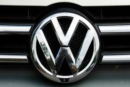 FILE - This Tuesday, Aug. 1, 2017, file photo shows the brand logo of German car maker Volkswagen on a car in Berlin. U.S. safety regulators are investigating complaints that a Volkswagen recall may not fix a wiring problem that can stop the front driver's air bag from inflating in a crash. The government probe covers nearly 416,000 vehicles including the 2010 to 2014 CC and Passat, the 2010 to 2013 Eos, the 2011 to 2014 Golf, GTI, Jetta and Tiguan, and the 2012 to 2014 Jetta Sportwagen. (AP Photo/Markus Schreiber, File) ORG XMIT: NYBZ533