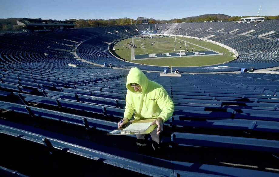 "Larry McKenna, a Giordano Construction project supervisor, inspects wooden seating at Yale Bowl on Friday as Yale prepares for ""The Game"" against Harvard. Photo: Peter Hvizdak / Hearst Connecticut Media / New Haven Register"