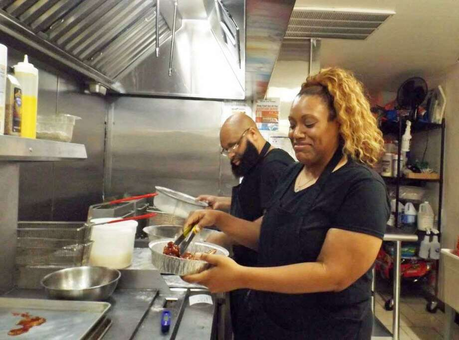 Rita and Marc Barham opened B& Wings and Things restaurant in Middletown's North End in August at 540 Main St. Photo: Sloan Brewster Photo