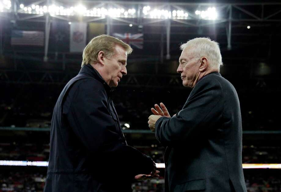 """FILE - In this Nov. 9, 2014, file photo, NFL Commissioner Roger Goodell, left, and Dallas Cowboys owner Jerry Jones talk at the NFL football game between the Jacksonville Jaguars and the Cowboys at Wembley Stadium in London. The Associated Press has obtained a letter sent to Jerry Jones' attorney accusing the Cowboys owner of """"conduct detrimental to the league's best interests"""" over his objection to a contract extension for Goodell. The letter accusing Jones of sabotaging the negotiations was sent to David Boies on Wednesday, Nov. 15, 2017. (AP Photo/Matt Dunham, File) Photo: Matt Dunham, STF / Copyright 2017 The Associated Press. All rights reserved."""