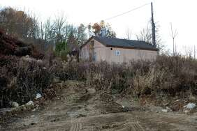 A lone building remains standing on a section of cleared land off of Victoria Drive in Monroe, Conn., on Friday Nov. 17, 2017. John Kimball of Monroe-based developer Kimball Landing Holdings, LLC released a statement today saying that Walmart officials informed his office that it has decided to no longer pursue building a Walmart Supercenter store on the site.