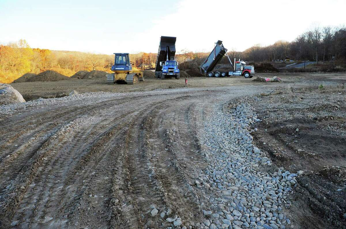 A view of cleared land off of Victoria Drive in Monroe, Conn., on Friday Nov. 17, 2017. For now, trucks in the background are dumping dirt from the nearby Route 110 and 111 road construction. John Kimball of Monroe-based developer Kimball Landing Holdings, LLC released a statement today saying that Walmart officials informed his office that it has decided to no longer pursue building a Walmart Supercenter store on the site.