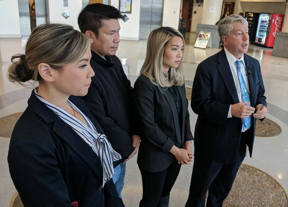 Attorney Linda Tran, father Hoai Le, aunt Xuyen Le and attorney Jeffery Campiche decry the conflict of interest in the King County inquest process in the case of Tommy Le, who was killed by King County deputies in June the night before he graduated from high school. They issued a statement in November at the Maleng Regional Justice Center in Kent.