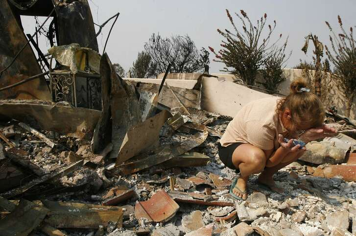 Beth Conner breaks down and cries in the rubble of her burned out home in the Rancho Bernardo neighborhood of San Diego, California, October 25, 2007. Firefighters gained the upper hand on nearly all of the California wildfires on Thursday as winds died down after five days battling 20 fires from the mountains north of Los Angeles down to the Mexican border. REUTERS/John Gress (UNITED STATES) Ran on: 10-26-2007 Beth Conner breaks down in the rubble of her home in the Rancho Bernardo neighborhood of San Diego, scene of one of the largest of Southern California's wildfires. In most other areas, firefighters were gaining the upper hand as Santa Ana winds died down. See story, Page A15 Ran on: 10-26-2007 Beth Conner breaks down in the rubble of her home in the Rancho Bernardo neighborhood of San Diego, scene of one of the largest of Southern California's wildfires. In most other areas, firefighters were gaining the upper hand as Santa Ana winds died down. See story, Page A15 Ran on: 10-26-2007  Ran on: 10-26-2007