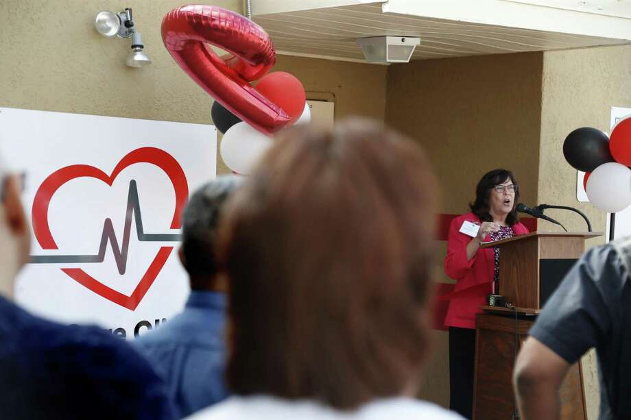 CEO Cynthia Nelson addresses the crowd Friday as San Antonio AIDS Foundation opens an HIV outpatient clinic with a pharmacy on the East Side at 818 E. Grayson Ave. Photo: Ron Cortes /For The San Antonio Express-News